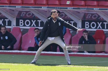 <div>Nottingham Forest v Huddersfield Town - Sky Bet Championship</div><div>NOTTINGHAM, ENGLAND - APRIL 17: Carlos Corberan, Manager of Huddersfield Town reacts during the Sky Bet Championship match between Nottingham Forest and Huddersfield Town at City Ground on April 17, 2021 in Nottingham, England. Sporting stadiums around the UK remain under strict restrictions due to the Coronavirus Pandemic as Government social distancing laws prohibit fans inside venues resulting in games being played behind closed doors. (Photo by Matthew Lewis/Getty Images)</div>