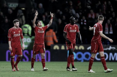 Coutinho points to the sky after his winning goal.