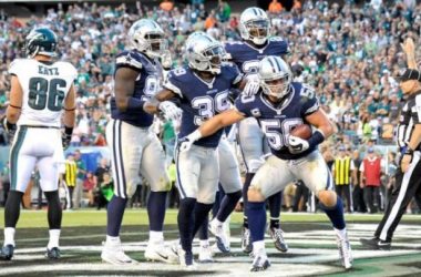 The Dallas Cowboys defense celebrates after Sean Lee's interception in the end zone. Image courtesy Eric Hartline USA TODAY Sports