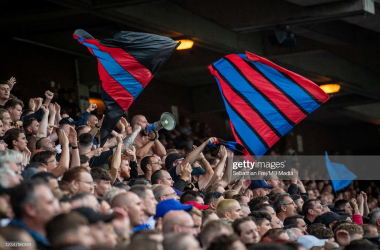 Flags being waved at Selhurst Park by the Crystal Palace ultras |Photo by Sebastian Frej/MB Media/Getty Images