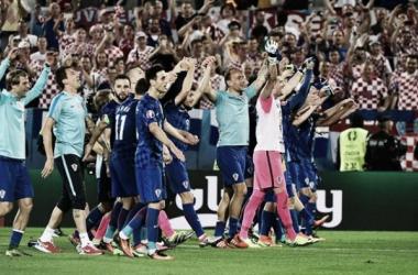 Croatia celebrating their 2-1 win over Spain. | Photo: uefa.com