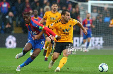 <div>Wolverhampton Wanderers Jonny holds of Crystal Palace's Wilfried Zaha during match between Crystal Palace and Wolverhampton Wanderers at Selhurst Park stadium (Photo by Action Foto Sport/NurPhoto via Getty Images)</div>