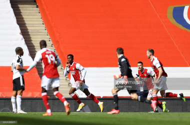 <div>Arsenal v Fulham - Premier League</div><div><br></div><div>LONDON, ENGLAND - APRIL 18: Eddie Nketiah of Arsenal celebrates after scoring his team's first goal during the Premier League match between Arsenal and Fulham at Emirates Stadium on April 18, 2021 in London, England. Sporting stadiums around the UK remain under strict restrictions due to the Coronavirus Pandemic as Government social distancing laws prohibit fans inside venues resulting in games being played behind closed doors. (Photo by Julian Finney/Getty Images)</div>