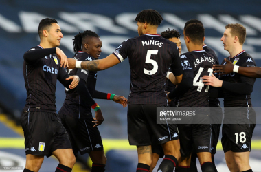 LEEDS, ENGLAND - FEBRUARY 27: Anwar El Ghazi of Aston Villa celebrates with teammates Bertrand Traore and Tyrone Mings after scoring his team's first goal during the Premier League match between Leeds United and Aston Villa at Elland Road on February 27, 2021 in Leeds, England. Sporting stadiums around the UK remain under strict restrictions due to the Coronavirus Pandemic as Government social distancing laws prohibit fans inside venues resulting in games being played behind closed doors. (Photo by Naomi Baker/Getty Images)