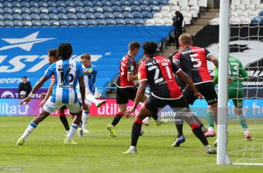 <div>Huddersfield Town v Coventry City - Sky Bet Championship</div><div>HUDDERSFIELD, ENGLAND - MAY 01: Danny Ward of Huddersfield Town scores their side's first goal during the Sky Bet Championship match between Huddersfield Town and Coventry City at John Smith's Stadium on May 01, 2021 in Huddersfield, England. Sporting stadiums around the UK remain under strict restrictions due to the Coronavirus Pandemic as Government social distancing laws prohibit fans inside venues resulting in games being played behind closed doors. (Photo by Alex Livesey/Getty Images)</div>