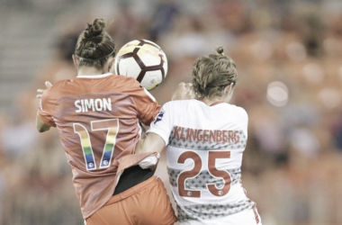 Kyah Simon (left) and Meghan Klingenberg (right) go for a ball at BBVA Compass Stadium in Houston, TX on June 22, 2018 | Photo: Houston Dash