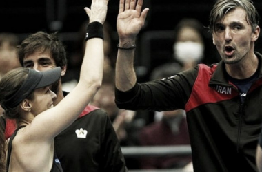 Goran Ivanisevic (right) high fives Martina Hingis (left) during the UAE Royals day one win. Photo: IPTL