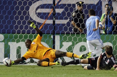 DC United's Bill Hamid stops David Villa's shot. Image by Frank Franklin, AP