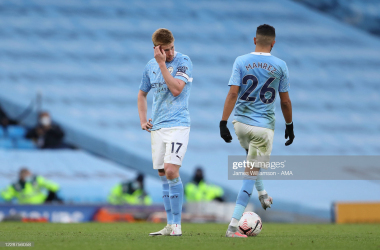 Kevin De Bruyne and Riyad Mahrez of Manchester City dejected during the Premier League match between Manchester City and Leicester City at Etihad Stadium on September 27, 2020 in Manchester, United Kingdom. Sporting stadiums around the UK remain under strict restrictions due to the Coronavirus Pandemic as Government social distancing laws prohibit fans inside venues resulting in games being played behind closed doors. (Photo by James Williamson - AMA/Getty Images)