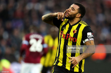 Troy Deeney celebrating after converting his penalty via Getty Images