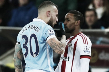 Defoe was accused of elbowing the City defender. | Photo: Four Four Two