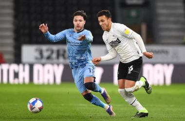 Lee Buchanan of Derby County battles with Callum O'Hare of Coventry City during the Sky Bet Championship match between Derby County and Coventry City at the Pride Park, Derby on Tuesday 1st December 2020. (Photo by Jon Hobley/MI News/NurPhoto via Getty Images)