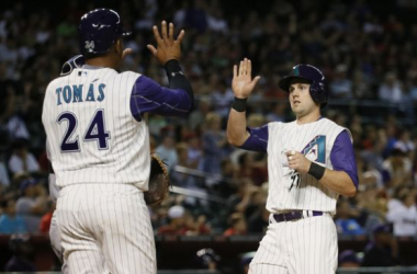 Chris Owings and Yasmany Tomas scored two of the eight runs Thursday night. AP/Matt York