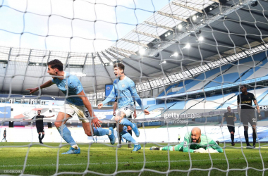 <div>MANCHESTER, ENGLAND - FEBRUARY 27: Ruben Dias of Manchester City celebrates after scoring his team's first goal during the Premier League match between Manchester City and West Ham United at Etihad Stadium on February 27, 2021 in Manchester, England. Sporting stadiums around the UK remain under strict restrictions due to the Coronavirus Pandemic as Government social distancing laws prohibit fans inside venues resulting in games being played behind closed doors. (Photo by Gareth Copley/Getty Images)</div>