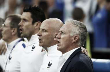 Deschamps pictured singing the French national anthem before the game (photo; Reuters)