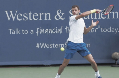 Grigor Dimitrov hits a forehand during his second round win. Photo: Noel Alberto