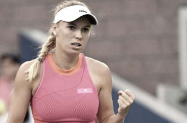 Caroline Wozniacki celebrates after defeating Mihaela Buzarnescu in the first round of the US Open. (US Open)