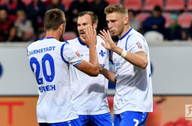 Darmstadt celebrate their first goal. | Photo: Bundesliga.