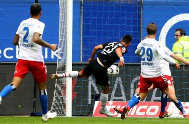 Sargis Adamyan scoring his first of the afternoon. | Photo: Bundesliga.