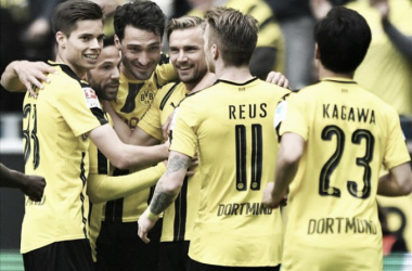 A collective of Borussia Dortmund players celebrate as they drew 2-2 with 1. FC Köln | Photo: goal.com