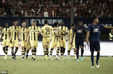 Above: Borussia Dortmund celebrating one o their four goals in their 4-1 win over Manchester United | Photo: Reuters