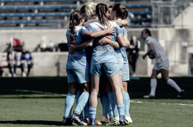 The Chicago Red Stars celebrate after a goal (Photo Courtesy: Chicago Red Stars)