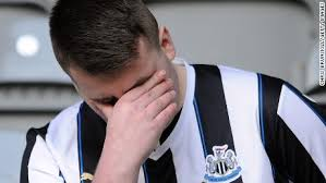 NEWCASTLE UPON TYNE, ENGLAND - MAY 04: A Newcastle United fan looks on prior to the Premier League match between Newcastle United and Liverpool FC at St. James Park on May 04, 2019 in Newcastle upon Tyne, United Kingdom. (Photo by Clive Brunskill/Getty Images)