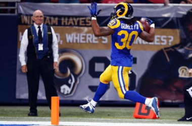 St. Louis Rams rookie running back Todd Gurley celebrates as he reaches the end zone. (Billy Hurst/AP)