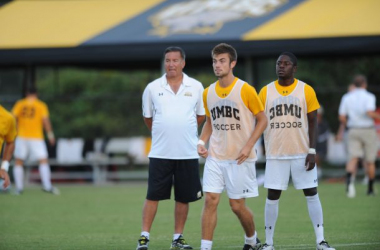 Coach Caringi giving his player instructions during practice. Photo Courtesy: UMBC