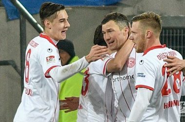 Düsseldorf celebrate one of their goals. | Photo: Bundesliga.