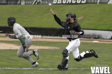 Eastern Michigan's Marquise Gill gets caught in a run down between third base and home plate. Photo: Walter Cronk