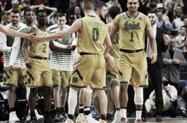 Notre Dame players celebrate after edging Princeton in the first round of the NCAA Tournament/Photo: Jeffrey T. Barnes/Associated Press
