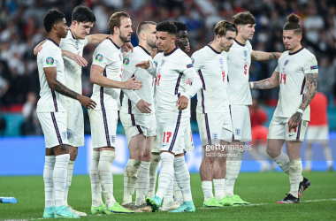 LONDON, ENGLAND - JULY 11: Jadon Sancho of England reacts with teammates after his penalty miss during the UEFA Euro 2020 Championship Final between Italy and England at Wembley Stadium on July 11, 2021 in London, England. (Photo by GES-Sportfoto/Getty Images)