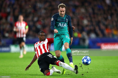 Christian Eriksen is tackled by Pablo Rosario during the Group B match of the UEFA Champions League between PSV and Tottenham Hotspur. (Photo by Dean Mouhtaropoulos/Getty Images)