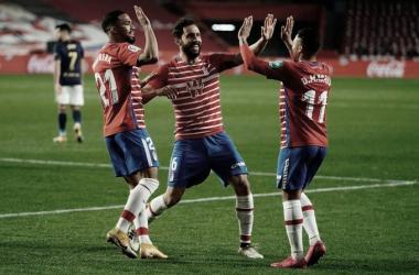 Germán, Yangel y Machís celebrando el segundo gol. Foto: Pepe Villoslada | Granada CF