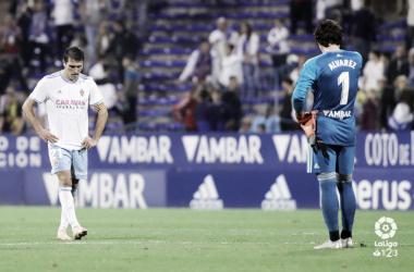 Zapater y Cristian hundidos sobre el césped | Foto: LaLiga