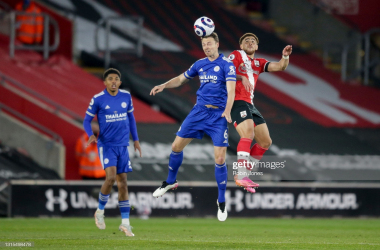 SOUTHAMPTON, ENGLAND - APRIL 30: Jonny Evans of Leicester City heads clear from Che Adams of Southampton during the Premier League match between Southampton and Leicester City at St Mary's Stadium on April 30, 2021 in Southampton, England. Sporting stadiums around the UK remain under strict restrictions due to the Coronavirus Pandemic as Government social distancing laws prohibit fans inside venues resulting in games being played behind closed doors. (Photo by Robin Jones/Getty Images)