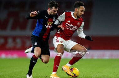 <div>Arsenal v Crystal Palace - Premier League</div><div><br></div><div>LONDON, ENGLAND - JANUARY 14: Pierre-Emerick Aubameyang of Arsenal battles for possession with James McArthur of Crystal Palace during the Premier League match between Arsenal and Crystal Palace at Emirates Stadium on January 14, 2021 in London, England. Sporting stadiums around England remain under strict restrictions due to the Coronavirus Pandemic as Government social distancing laws prohibit fans inside venues resulting in games being played behind closed doors. (Photo by Alastair Grant - Pool/Getty Images)</div>