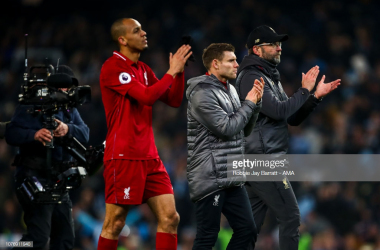 """Fabinho, James Milner and<span style=""""font-size:11.0pt;line-height:107%; font-family:""""Calibri"""",sans-serif;mso-ascii-theme-font:minor-latin;mso-fareast-font-family: Calibri;mso-fareast-theme-font:minor-latin;mso-hansi-theme-font:minor-latin; mso-bidi-font-family:""""Times New Roman"""";mso-bidi-theme-font:minor-bidi; mso-ansi-language:EN-GB;mso-fareast-language:EN-US;mso-bidi-language:AR-SA"""">Jürgen Klopp after Liverpool's 2-1 defeat to Manchester City at the Etihad Stadium (Getty Images)</span>"""