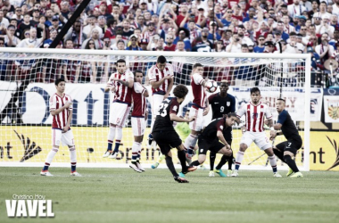 Fabian Johnson takes a free kick.