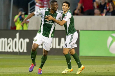 Fanendo Adi and Diego Valeri celebrate a goal - Photo by USA Today