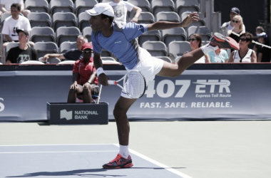 Félix Auger-Aliassime follows through on a serve during his first round qualifying match against James Duckworth at the 2016 Rogers Cup.   Photo: Max Gao