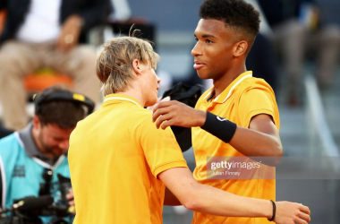 Canadian hotshots Denis Shapovalov and Felix Auger Aliassime embrace at the 2019 Mutua Madrid Masters (Julian Finney/Getty Images)