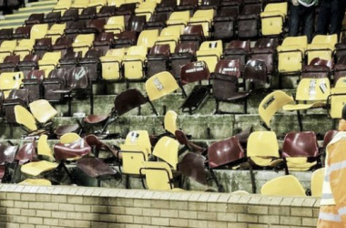 Stewards survey the damage after Friday's game