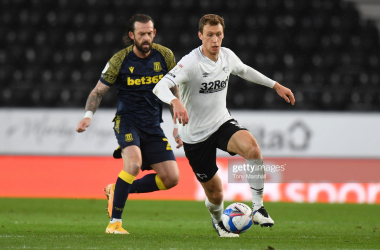 Krystian Bielik of Derby County is challenged by Steven Fletcher of Stoke City during the Sky Bet Championship match between Derby County and Stoke City at Pride Park Stadium last season. (Photo by Tony Marshall/Getty Images)