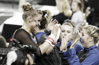 Bridget Sloan of Florida high fives teammates after a stellar routine at the NCAA Women's Gymnastics Championships/Photo courtesy: Erin Long