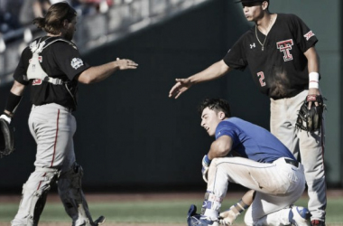 Tyler Floyd (left), and Orlando Garcia (standing right) shake hands after Garcia tagged out India (kneeling) to send the Florida Gators home from the College World Series | Photo Courtesy: Ted Kirk (AP)