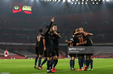 <div>LONDON, ENGLAND - DECEMBER 22: Phil Foden of Manchester City celebrates after scoring their sides third goal with teammate Joao Cancelo during the Carabao Cup Quarter Final match between Arsenal and Manchester City at Emirates Stadium on December 22, 2020 in London, England. The match will be played without fans, behind closed doors as a Covid-19 precaution. (Photo by Catherine Ivill/Getty Images)</div>