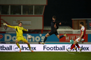 <div>CHELTENHAM, ENGLAND - JANUARY 23: Phil Foden of Manchester City scores their sides first goal past Josh Griffiths of Cheltenham Town during The Emirates FA Cup Fourth Round match between Cheltenham Town and Manchester City at Jonny Rocks Stadium on January 23, 2021 in Cheltenham, England. (Photo by Manchester City FC/Manchester City FC via Getty Images)</div>