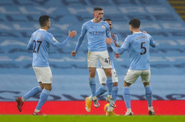 MANCHESTER, ENGLAND - JANUARY 13: Phil Foden of Manchester City celebrates after scoring a goal to make it 1-0 during the Premier League match between Manchester City and Brighton & Hove Albion at Etihad Stadium on January 13, 2021 in Manchester, United Kingdom. Sporting stadiums around England remain under strict restrictions due to the Coronavirus Pandemic as Government social distancing laws prohibit fans inside venues resulting in games being played behind closed doors. (Photo by James Williamson - AMA/Getty Images)